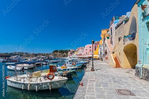 Garden Poster Napels Fishing boats in the harbor in Marina di Corricella, Procida Island, Gulf of Naples, Italy.