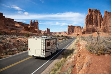 Camper Riding On A Scenic Road In The Red Rock Canyons During A Vibrant Sunny Day. Taken In Arches National Park, Located Near Moab, Utah, United States.