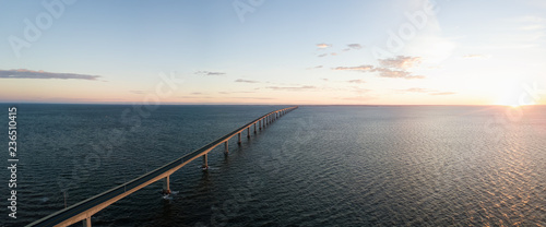 Fotografía  Aerial Panoramic view of Confederation Bridge to Prince Edward Island during a vibrant sunny sunrise