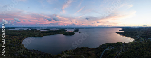 Fotografia Aerial panoramic landscape view of a beautiful bay on the Great Lakes, Lake Huron, during a vibrant sunset