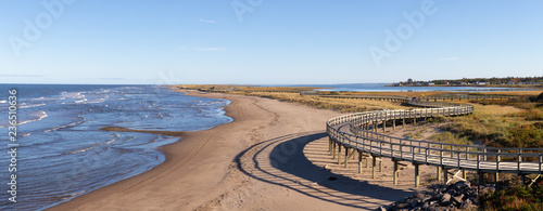 Panoramic view of a beautiful sandy beach on the Atlantic Ocean Coast. Taken in La Dune de Bouctouche, New Brunswick, Canada.