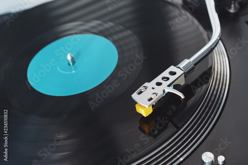 Turntable vinyl record player on the background of a sunset over the
