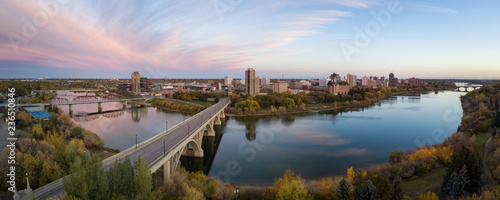 Aerial panoramic view of a bridge going over Saskatchewan River during a vibrant sunrise in the Fall Season Canvas-taulu