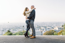 Couple In Montmartre With Panoramic View Of Paris