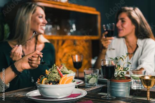 Vegetarian Restaurant. Female Friends In A Vegetarian Restaurant