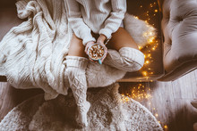 Girl Drinking Warm Cocoa On A Sofa