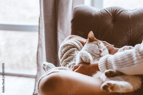 Girl with cat relaxing on a sofa