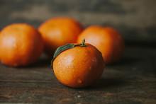 Tangerine On Wooden Background