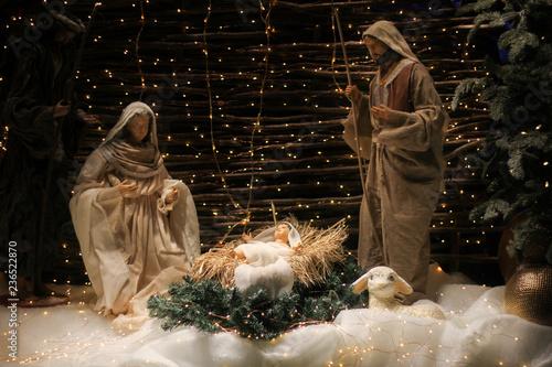 Fototapeta Christmas Manger scene with figures including Jesus, Mary, Joseph, sheep and magi