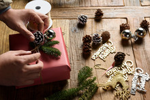 Man Prepares For Xmas Decoration And Gift
