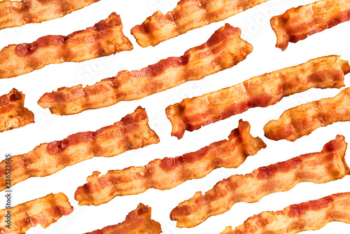 Background of bacon slices disposed in diagonal and isolated on white background. Directly above.