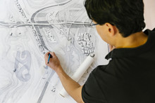 Architect Working On Drawings In Office