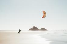 Kitesurfer Walking On The Beach