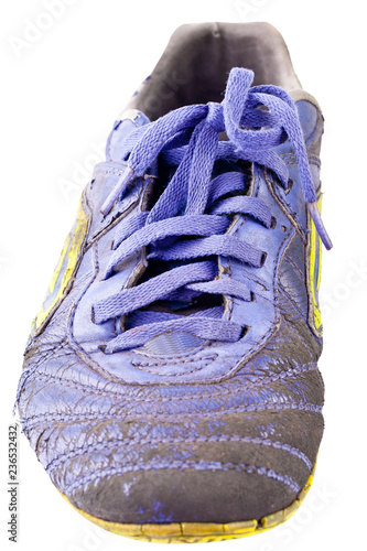 Fotografía  old futsal shoes on white background football sportware object isolated