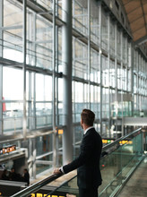 Thoughtful Businessman In Airport Building