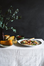 Roasted Pumpkin And Pomegranate Salad Served On A Platter On A Table.
