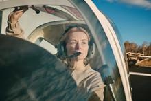 Female Aviator In Aircraft