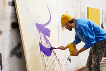 Artist Painting On Canvas In S...