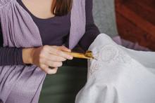 Female Artist Doing Batik Technique On The Piece Of Cloth