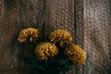 Above View Of Yellow Flowers On A Wooden Table
