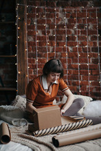 Charming Woman Wrapping Presents