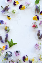 Flowers And Frozen Fruit On White Marble Background