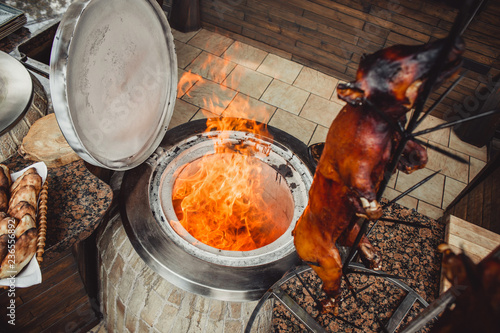 Grilled pig and lamb on fire and coal, hot tandoor grill. Hot Meat dishes