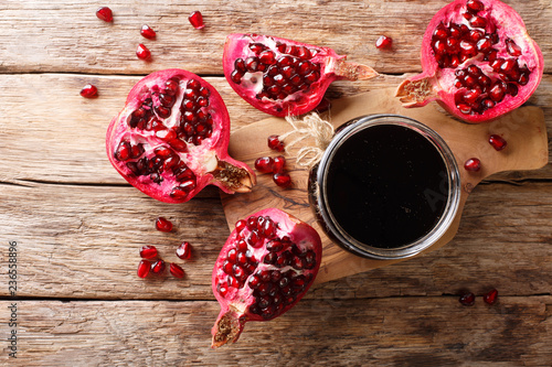 Delicious spicy pomegranate sauce narsharab with spices for seasoning meat dishes close-up. Horizontal top view