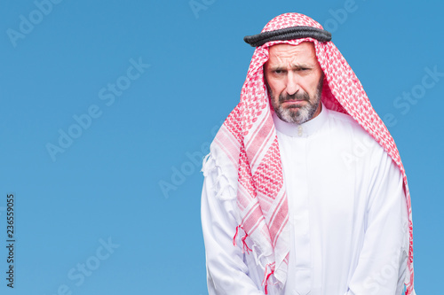 Senior arab man wearing keffiyeh over isolated background depressed and worry for distress, crying angry and afraid Fototapeta