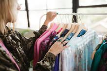 Clothing Designer In Her Industrial Studio Working.