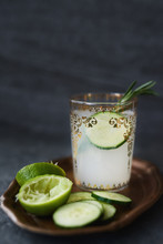 Lime Juice With Cucumber And Rosemary On Dark Background