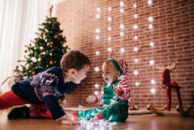 Two Brothers Having Fun Preparing For Christmas At Home.