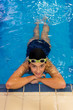 Portrait of young girl in swimming pool