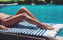 Young Slim Woman's Legs In Bik...