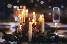 Cosy Table Setting With Candles For Dinner Party