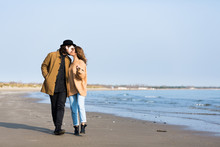 Beautiful Couple Outdoors By The Sea