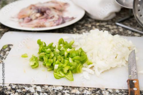 Fotobehang Kruiderij green pepper and onion cut