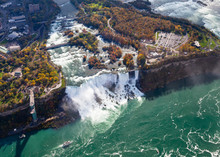 Niagara Falls Aerial View.  An Aerial View Of The American Falls, A Part Of The Niagara Falls.  The Falls Straddle The Border Between America And Canada.