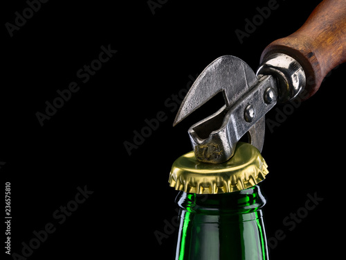 Tuinposter Bier / Cider Opening of beer bottle by can opener