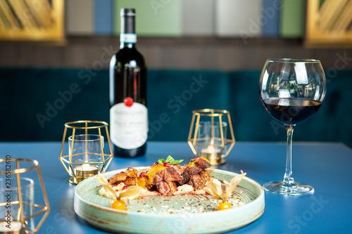 Spoed Foto op Canvas Klaar gerecht Fine dining design in restaurant with good red wine. Tasty gastronomy