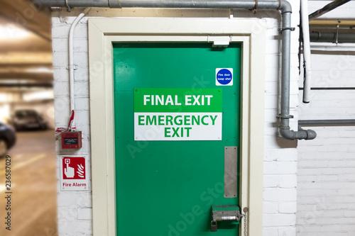 Photo  final exit emergency green door car park