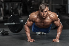 Muscular Man Working Out In Gym Doing Push-ups Exercises, Strong Male Naked Torso Abs