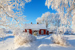 canvas print picture - Idyllic red cottage in a beautiful winter landscape