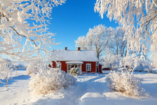 Idyllic Red Cottage In A Beautiful Winter Landscape