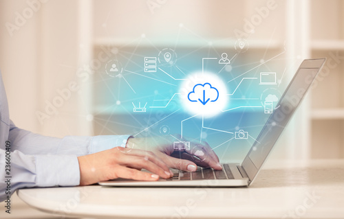 Fotografía  Business woman in homey environment using laptop with  online storage and cloud