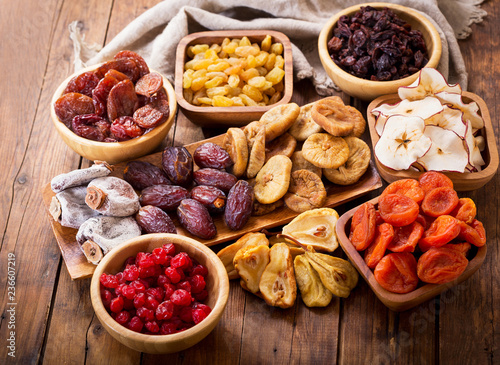 Fototapeta dried fruits on wooden table, top view obraz