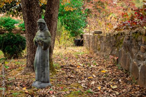 Fotografie, Obraz  Statue of a Catholic Monk in the Garden