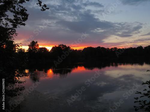 Fotobehang Rood sunset over lake