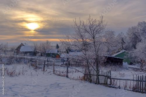 Fotobehang Lavendel beautiful winter landscape evening in a small village