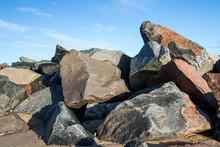 Pile Of Multicolored Rocks And Boulders As Coastal Erosion Beach Sea Flood Defence